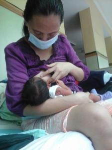 Political prisoner Miradel Torres with her baby Karl.